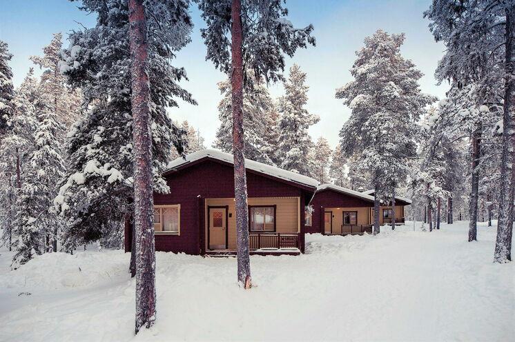 In einem solchen Holzhaus befindet sich Ihr Zimmer